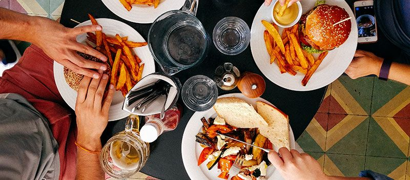 how to start a restaurant table full of food