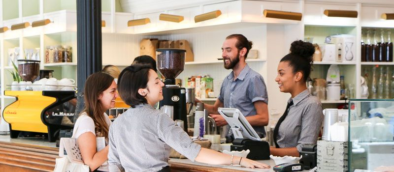 cashier-with-customers-at-cafe