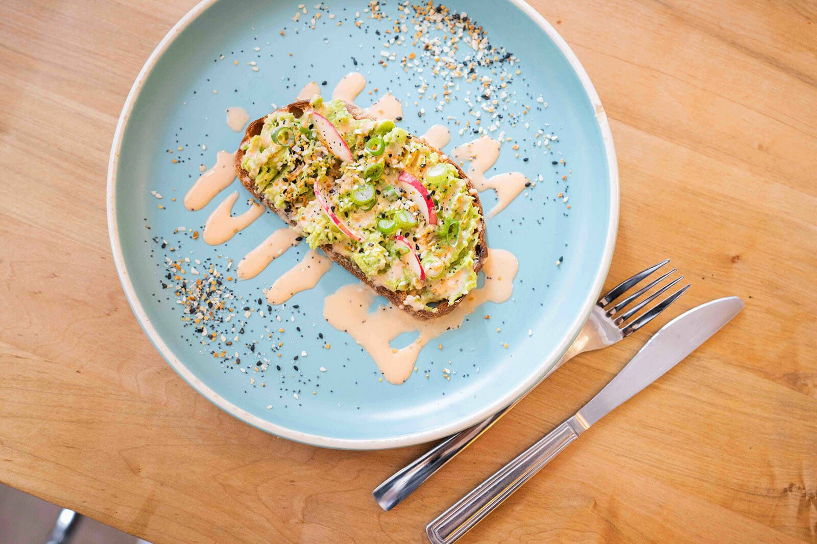 avocado toast on blue plate