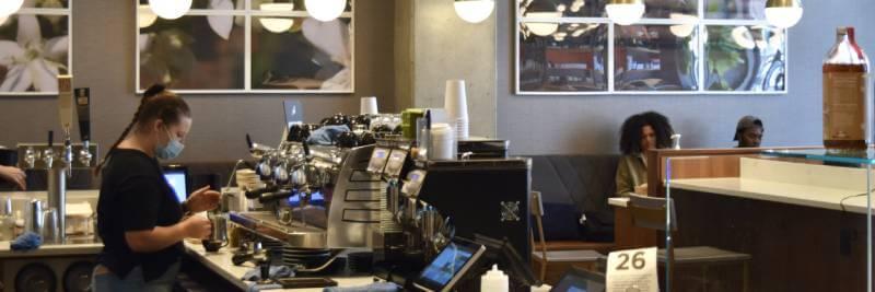 People working at Kaldi s Coffee